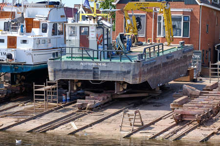 Urk, The Netherlands - June 22 2020: Two yachts for repair and maintenance in the dockyard of Urk, the Netherlands