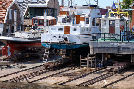 Urk, The Netherlands - June 22 2020: Three yachts for repair and maintenance in the dockyard of Urk, the Netherlands