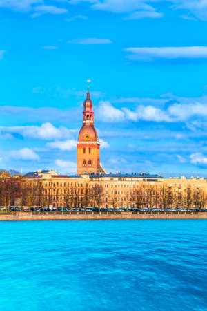 Beautiful view of the tower of the Dome Cathedral on the banks of the Daugava River in Riga, Latvia on a sunny day Stock Photo
