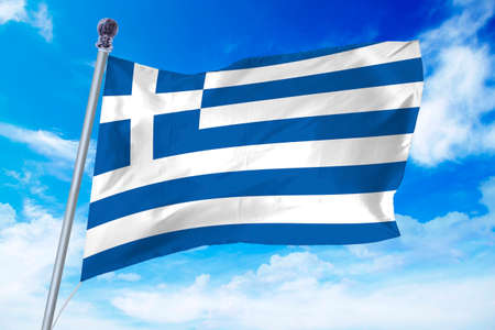 Flag of Greece developing against a clear blue sky