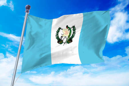 Flag of Guatemala developing against a clear blue sky