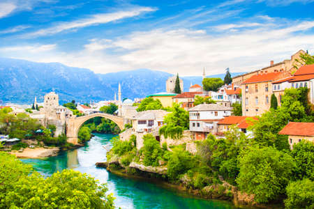 Beautiful view Old bridge in Mostar on the Neretva river, Bosnia and Herzegovina, on a sunny day 스톡 콘텐츠