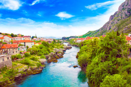 Beautiful view in Mostar on the Neretva river, Bosnia and Herzegovina, on a sunny day