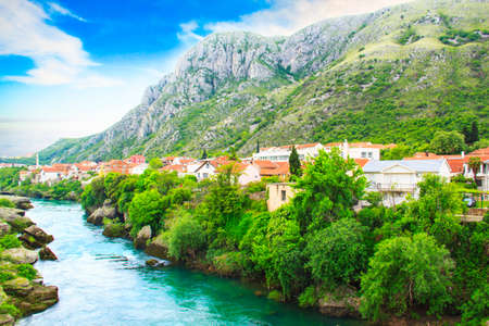 balkans: Beautiful view in Mostar on the Neretva river, Bosnia and Herzegovina, on a sunny day