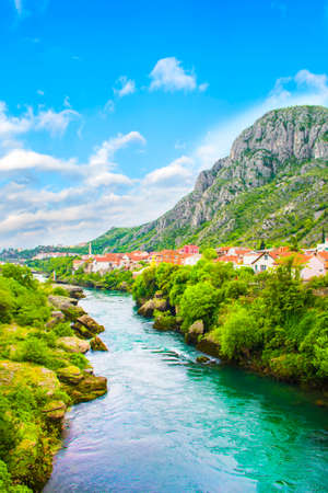A beautiful view of the Neretva River in Mostar, Bosnia and Herzegovina, on a sunny summer day Standard-Bild