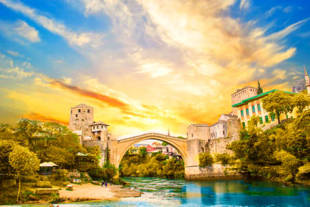 A beautiful view of the old bridge across the Neretva River in Mostar, Bosnia and Herzegovina, on a sunset