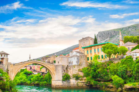 A beautiful view of the old bridge across the Neretva River in Mostar, Bosnia and Herzegovina, on a sunny summer day