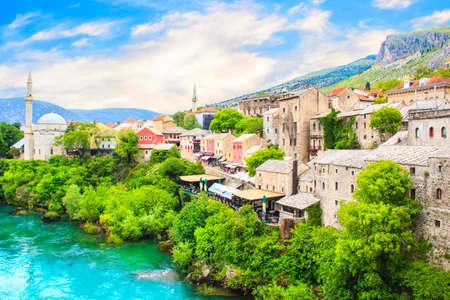 Beautiful view of the Karadjozbegov mosque jamia on the banks of the Neretva River in Mostar, Bosnia and Herzegovina