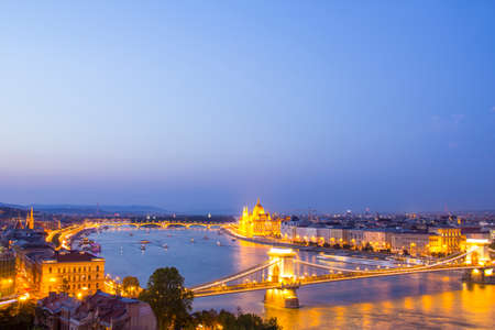 Beautiful view of the Hungarian Parliament and the chain in the panorama of Budapest at night, Hungary