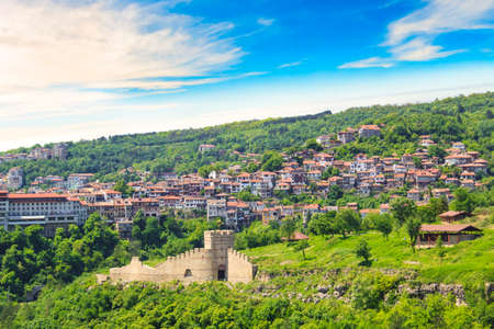 A beautiful view of the Tsarevets fortress among the green hills in Veliko Tarnovo, Bulgaria Stock Photo