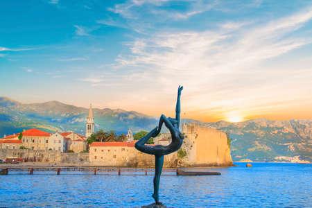 Beautiful view of the sculpture Ballerina Dancer of Budva at sunset, Budva, Montenegro Stock Photo