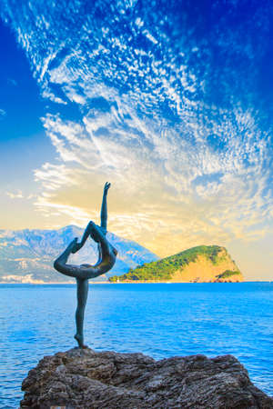Beautiful view of the sculpture Ballerina Dancer of Budva at sunset, Budva, Montenegro Editorial
