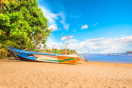 Bright boats on the tropical beach of Bentota, Sri Lanka on a sunny day Reklamní fotografie