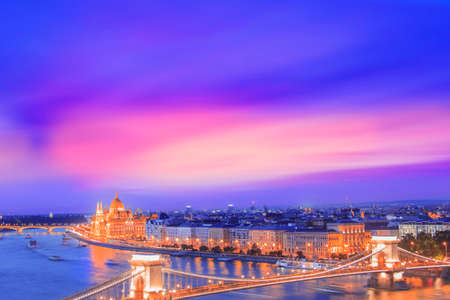 Beautiful view of the Hungarian Parliament and the Szechenyi chain bridge across the Danube in the panorama of Budapest at night, Hungary Reklamní fotografie
