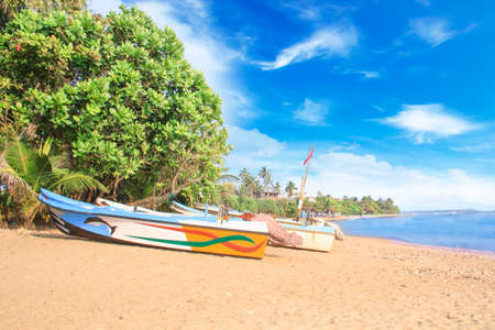 Bright boats on the tropical beach of Bentota, Sri Lanka on a sunny day Reklamní fotografie - 92928480