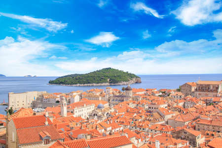 Beautiful view of the bell tower and the island Lokrum in the old town of Dubrovnik, Croatia Standard-Bild