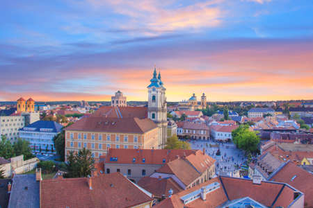 Beautiful view of the Minorit church and the panorama of the city of Eger, Hungary, at sunset Stock Photo