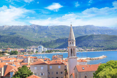 View of the rooftops and the bay of Budva in Montenegro in the summer sunny day