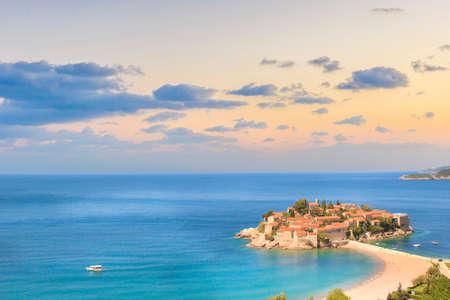 Beautiful view of the island-resort of St. Stefan (Sveti Stefan) on the Budva Riviera, Budva, Montenegro on a sunny day 스톡 콘텐츠
