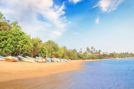 Bright boats on the tropical beach of Bentota, Sri Lanka on a sunny day Reklamní fotografie