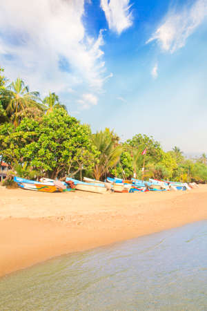 Bright boats on the tropical beach of Bentota, Sri Lanka on a sunny day Stock Photo