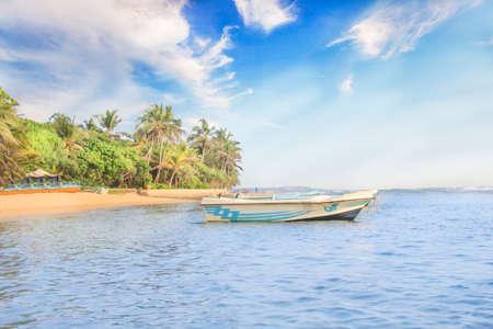 Bright boats on the tropical beach of Bentota, Sri Lanka on a sunny day Reklamní fotografie - 94279143