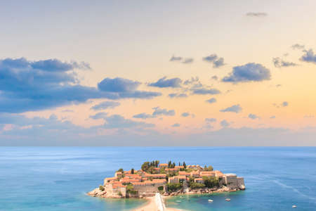 Beautiful view of the island-resort of St. Stefan (Sveti Stefan) on the Budva Riviera, Budva, Montenegro on a sunny day 写真素材