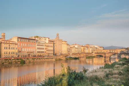 Beautiful view of the Ponte Vecchio bridge across the Arno River in Florence, Italy