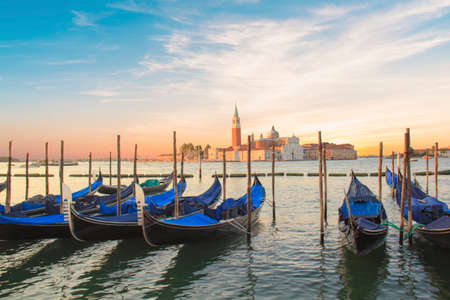 Beautiful view of the gondolas and the Cathedral of San Giorgio Maggiore, on an island in the Venetian lagoon, Venice, Italy