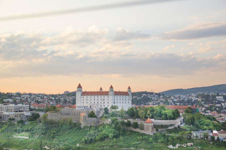 Beautiful view of the Bratislava castle on the banks of the Danube in the old town of Bratislava, Slovakia on a sunny summer day.