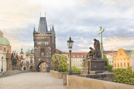 Beautiful view of Old Town Tower of Charles Bridge at dawn in Prague, Czech Republic