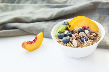 Oatmeal porridge with blueberries. Superfood for healthy nutritious breakfast Standard-Bild