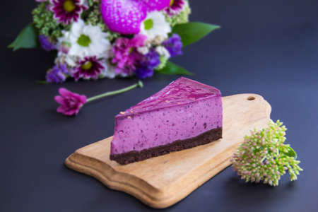 Homemade cheesecake with fresh blueberries and mint for dessert - healthy organic summer dessert pie cheesecake. Creative atmospheric decoration.