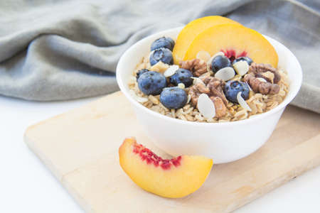Oatmeal porridge with blueberries. Superfood for healthy nutritious breakfast Reklamní fotografie
