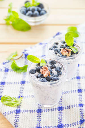 Juicy and fresh blueberries with green leaves. Creative atmospheric decoration