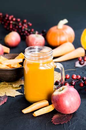 Halloween cocktail, pumpkin orange drink with spices. Dark vintage dirty background. Creative atmospheric decoration
