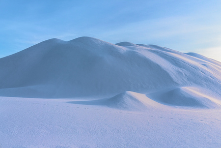 Snowdrift. Ukrainian winter. A mountain covered by snow. A snow desert. Winter sunny day. Kriviy Rih, Ukraine.