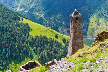 Tusheti, Georgia: an ancient tower in an alpine village Kvavlo with a breathtaking aerial view of mountains and forests. Tusheti is an isolated mountainous region attracting most adventurous travelers