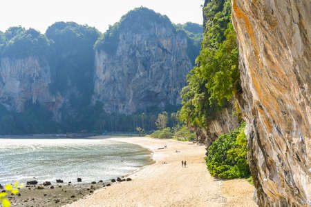 Tonsai Beach in low season (July). An almost empty strip of sand, steep cliffs, and jungles. Ton Sai is a more secluded and budget location of famous Railay Peninsula. Traveling in Krabi, Thailand.