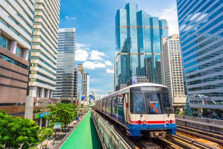 Bangkok, Thailand - June 9, 2019: a train of BTS (Skytrain) travels among skyscrapers of the downtown (Bang Rak district). Redakční