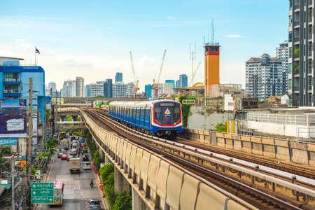 Bangkok - June 25, 2019: a train arrives in On Nut BTS station, with Sukhumvit Road beneath. Redakční