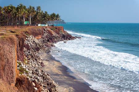 Varkala, Kerala, India. Steep coast, palm trees and sea horizon. 2 km away from the Central Beach.
