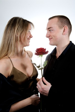 couple romance, man with a rose and his girlfriend Stock Photo - 4284837