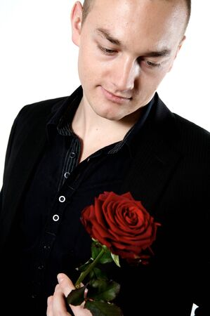 man looking a rose on a with background Stock Photo - 4284839