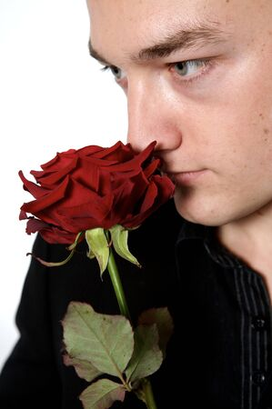 man holding a rose on a with background close up