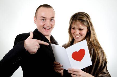 couple reading an happy poem white background Stock Photo