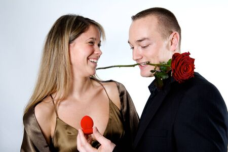 happy couple rose in the mouth of the guy