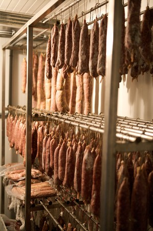 seasonning french sausage in the special fridge of a butcher