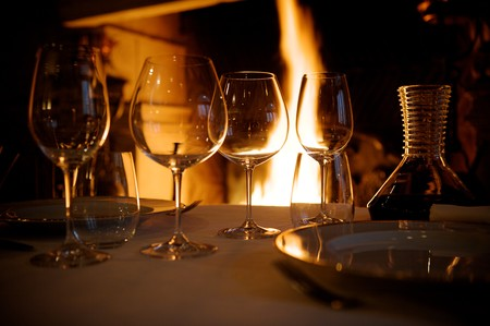 romantic evening with wine: at restaurant warm ambience glasses and wines
