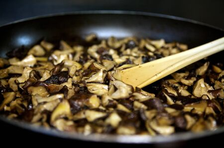 mushrooms in a pan in the kitchen french cooking Stock Photo